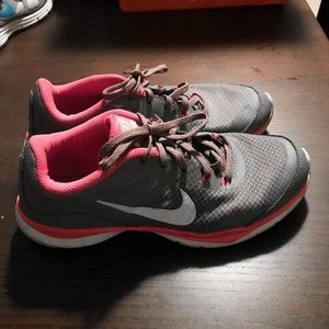 NIKE pink athletic running shoes